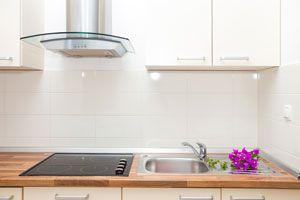 Ilustración de Cómo Limpiar los Extractores de Cocina
