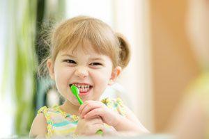 Ilustración de Cómo cuidar los dientes de los niños