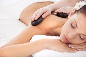 Ilustración de Cómo hacer masajes con piedras calientes