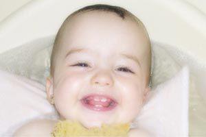 Ilustración de Cómo ayudar y cuidar a nuestro bebé durante la primera dentición